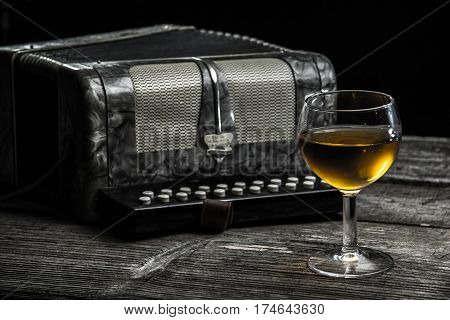 Old Accordion With Wine