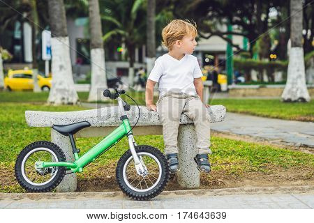 Active Blond Kid Boy And Bicycle Near The Sea. Toddler Child Dreaming And Having Fun On Warm Summer