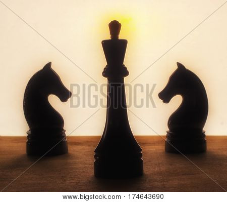 Chess King and horses silhouette darkened chess pieces a very ancient and interesting game that develops logical thinking