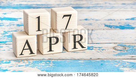 April 17Th. Wooden Cubes With Date Of 17 April  On Old Blue Wooden Background.