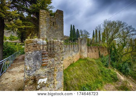 The big strong wall of the castle at Tomar Portugal.