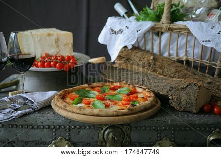 Neapolitan pizza with mozzarella, cherry tomato and fresh basil