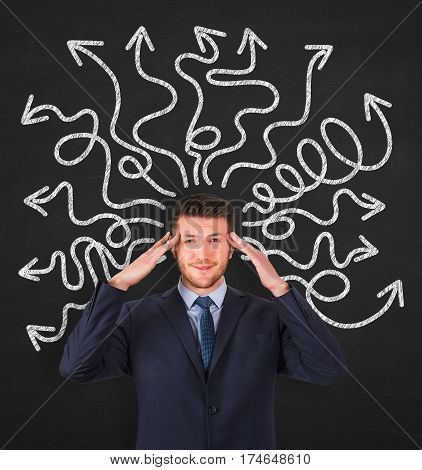 Business person thinking a solution on chalkboard