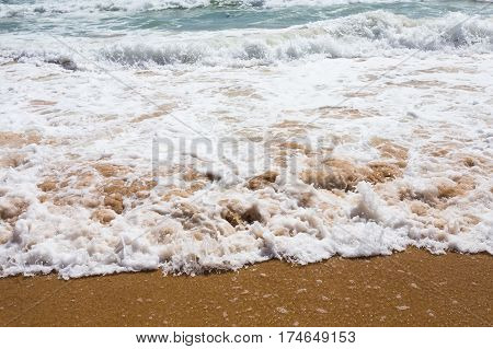 Beautiful clear mediterranean water lapping on the shore