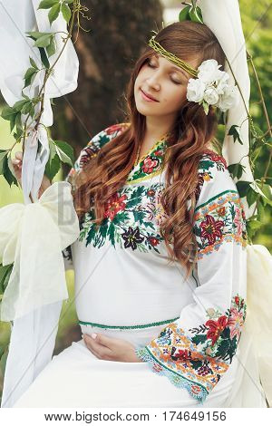 Gorgeous Brunette Woman With White Roses Wreath In Traditional Embroidered Dress Face Closeup. Tende