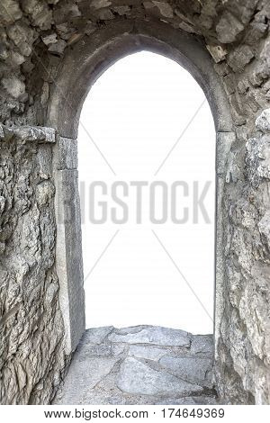 Massive stone wall with open door and white copy space behind