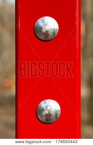 two shining bolts of a head on a red background macro