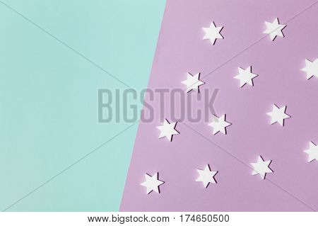 Modern geometric horizontal rectangular lilac and mint abstract minimal background with white stars, lying flat, top view, diagonal asymmetric composition. Have an empty place for your text.