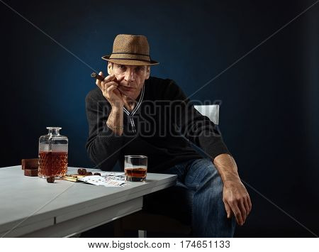 man with whiskey and cigar studio shot