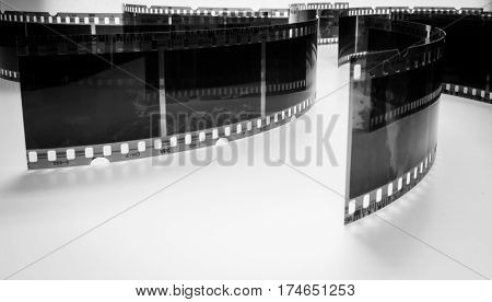 black and white photo of old negatives on a white background