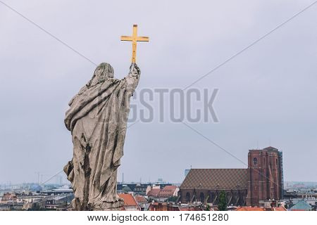 Wroclaw, Silesia, Poland - September, 18th, 2016. Wroclaw skyline and St. Mary Magdalene church high view and the statue on the top of Wroclaw university building housing the Aula Leopoldina room.
