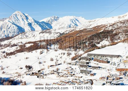 View over the snow-clad slopes of Sestriere village - famous ski resort in Piedmont