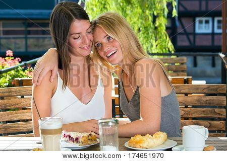 Young Beautiful Women Together In Cafe