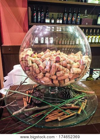 NEOS MARMARAS, SITHONIA, CHALKIDIKI GREECE - JUNE 22, 2016: Porto Carras Winery, wine store interior view. The big clear glass with wine corks.