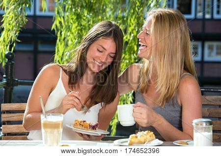 Women In Cafe Eating Desert And Laughing