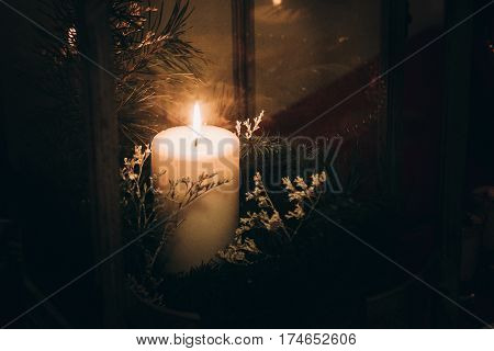 Romantic White Burning Candle In Wooden Lantern With Fir Tree Branch Decoration At Luxury Restaurant