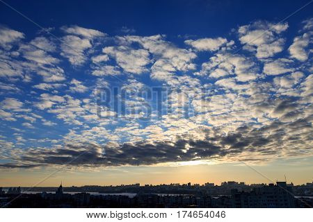 Beautiful city sunset with copyspace, dramatic sky with spindrift clouds and dark cityscape, Voronezh