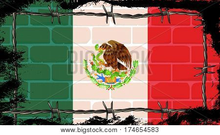 The Mexican Flag on a brick wall with barbed wire border