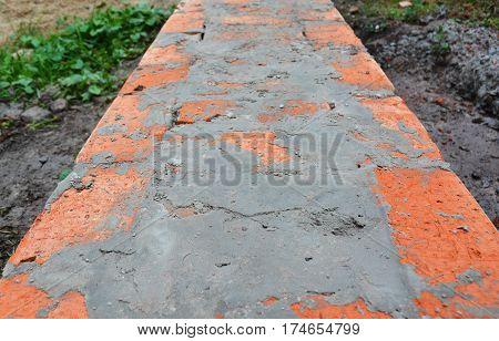 Close up on bricklaying brick wall construction