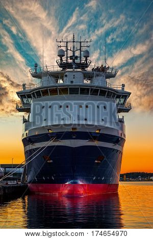 Tugboat moored in a harbour in at sunset. Stavanger Norway.
