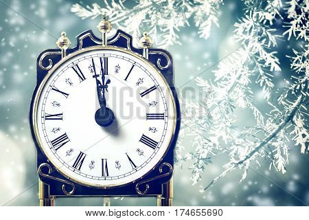 Happy New Year card with midnight clock and frosty branches
