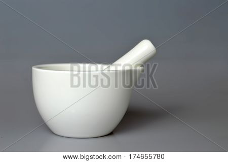 Ceramic mortar and pestle on grey background