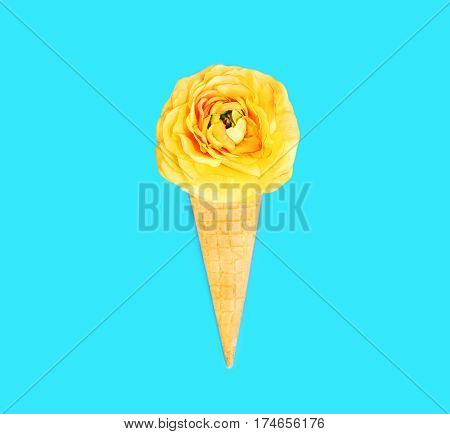 Ice Cream Cone With Flowers Over Blue Colorful Background Top View