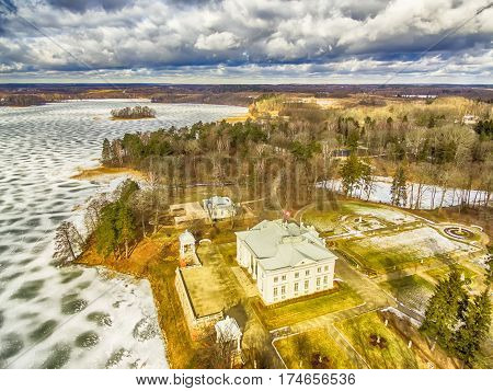 Trakai, Lithuania: Aerial UAV top view of Uzutrakis Palace in the winter