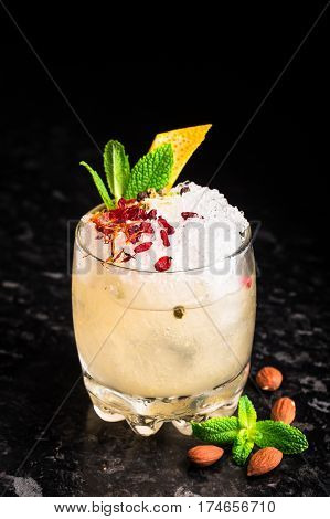 Delicious cocktail with garnish on marble table