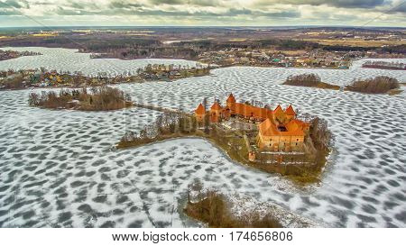 Trakai, Lithuania: aerial winter UAV top view, flat lay of gothic Island Castle and city of Trakai in the winter