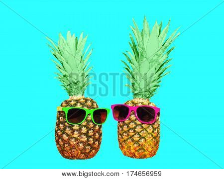 Two Pineapple And Sunglasses On Blue Background, Colorful Ananas Photo