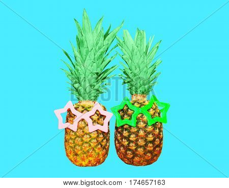 Two Pineapple With Sunglasses On Blue Background, Colorful Ananas