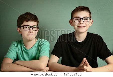 short sighted teen boys in glasses close up portrait