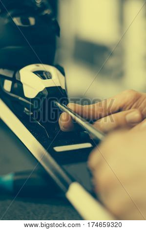 Ski Repair Shop Worker Adjust The Bindings