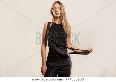 Sexy Young Woman In Stylish Overalls In Studio Photo
