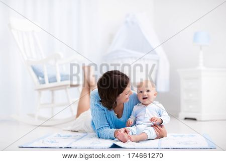 Mother And Baby Playing On The Floor