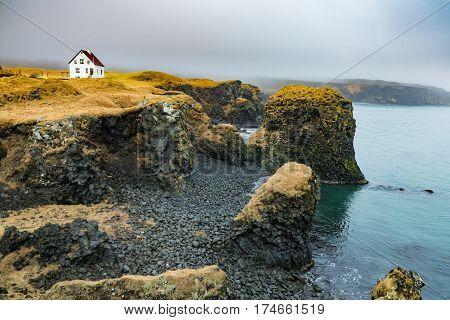 Along the coast of the fishing village of Arnarstapi Iceland