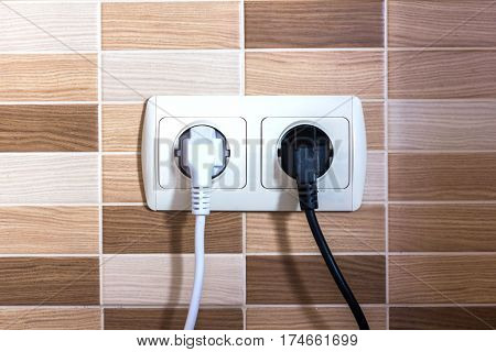 Electric outlet on textural background. Couple of electric outlet