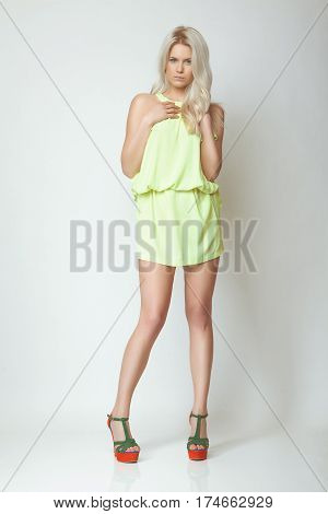attractive fashion blond model girl with blue eyes long leg