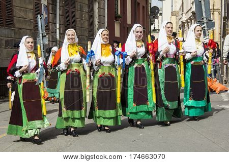 CAGLIARI, ITALY - May 1, 2013: 357 Religious Procession of Sant'Efisio - group of beautiful women parading in traditional Sardinian costume - Sardinia