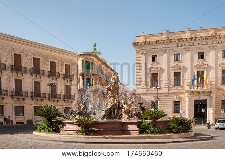 SYRACUSE ITALY - SEPTEMBER 14 2015: The fountain on the square Archimedes in Syracuse. In the center of the fountain is a magnificent statue of Diana - hunter surrounded by sirens and tritons.