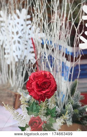 vibrant red cloth rose display in shop window