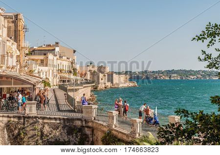 SYRACUSE ITALY - SEPTEMBER 14 2015: Coast of Ortigia island at city of Syracuse Sicily Italy