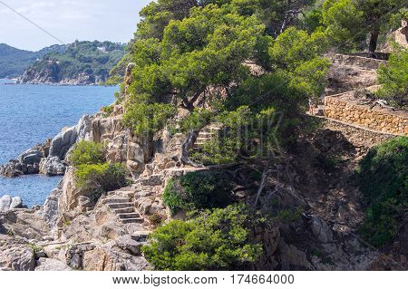 Stairway leading to the sea in Lloret de Mar, Girona, Catalonia, Spain