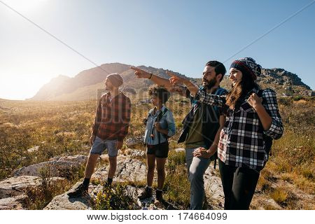 Young People Hiking On Extreme Terrain