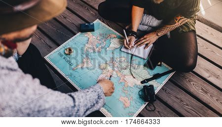 Tourist Planning Vacation Using World Map.