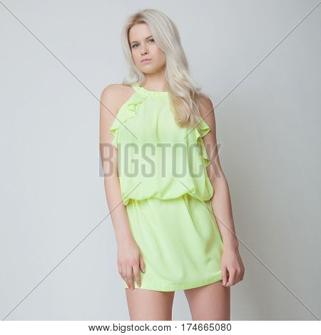 attractive fashion blond model girl with blue eyes
