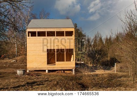 Spring On The Construction Of Ecological Buildings. Unfinished Wooden House On The Edge Of The Fores