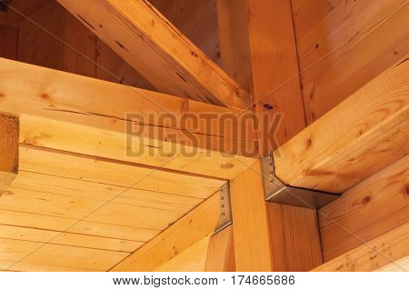 Wooden Beams On The Construction Of Ecological Buildings. Construction Site Timber Construction.