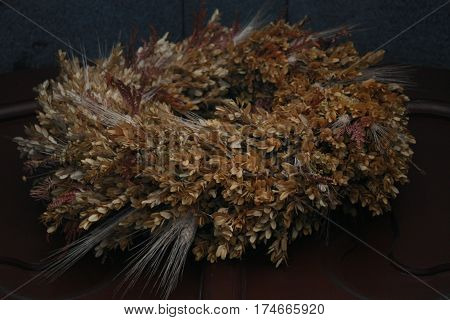 a wreath of dried flowers on the feast of the Nativity